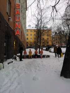 Men finding warmth in a sauna of Kallio, Helsinki.